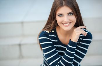 smiling healthy young woman with long dark hair